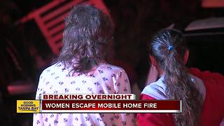 Women escape mobile home fire - Video