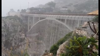 Heavy Rainfall Turns Bridge Into Waterfall in Southern Italy
