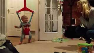 Adorable Toddler Jumps for Joy With Mother