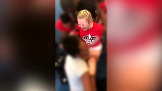 VIDEO: Cheerleader forced to do split despite pleas to stop - Video