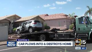 Car crashes into Surprise home, driver hurt - Video