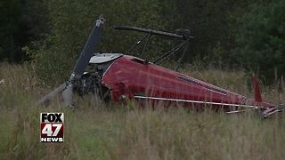 Man dies, grandson hurt after Michigan helicopter crash - Video