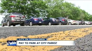 City council discusses charging a parking fee at parks - Video
