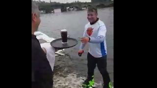 Man Orders Pint of Guinness, Drinks It While Hydro-Boarding Over Water - Video