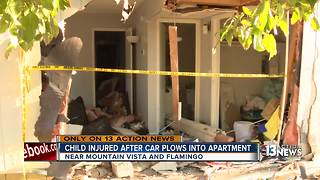 Child injured after car plows into living room - Video