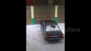 Hailstones the size of tennis balls damage vehicles in northwest China - Video