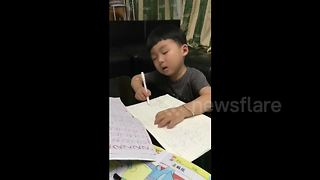 Cute Kid Falls Asleep While Doing Homework - Video