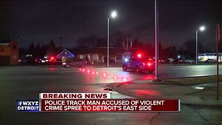 Suspect in carjacking, armed robbery & kidnapping being tracked on foot in Detroit - Video