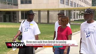 Men walking from Detroit to Lansing to protest child support laws - Video