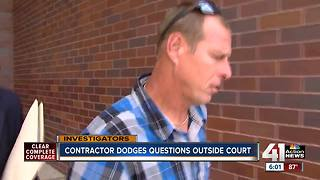 Concrete contractor facing felony charges confronted outside court