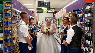Pre-nup in aisle five! Bride poses for unforgettable wedding photoshoot at supermarket