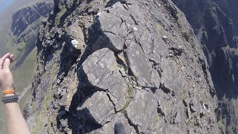 Terrifying images from body camera show hiker just inches away sheer drop on mountain edge
