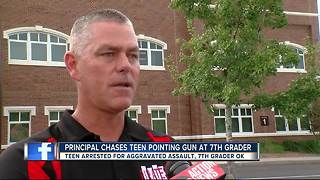 Student arrested for bringing fake gun to school, holding it to 7th grader's throat - Video