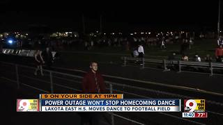 Without power, Lakota East High School holds homecoming dance under the lights - Video