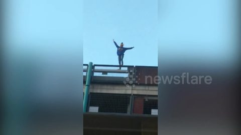 Daredevil woman in UK climbs eight-storey car park with no safety harness