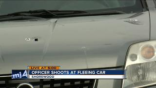 Shorewood police officer fired at a car that hit squad - Video