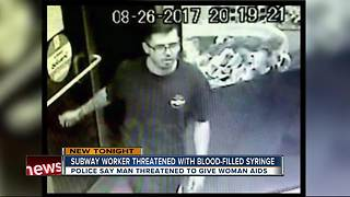 Subway worker threatened with blood-filled syringe - Video