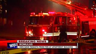 Two kids rush to save people from burning Romulus apartment - Video