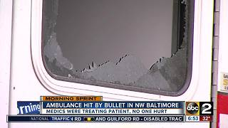 Ambulance hit by bullet in Baltimore - Video
