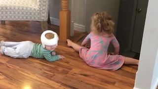A Tot Girl Watches Over Her Baby Brother - Video