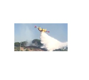 Aerial Firefighters Douse Messina Wildfires - Video