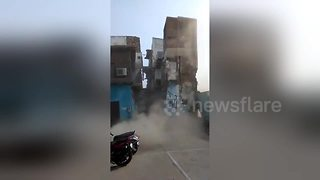 Terrifying moment abandoned building collapses - Video