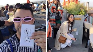 Prankster confuses bar customers who want to charge their phone with fake electrical outlet sticker