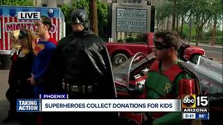 Superheroes collecting donations for kids in Phoenix Saturday - Video