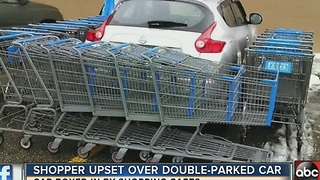 Shopper upset over double-parked car - Video