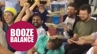 Hilarious moment cricket fans stack drinks on a sleeping fan - Video