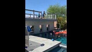 Brothers hit back-to-back trick shots before jumping into pool