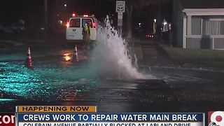 Crews work to repair water main break