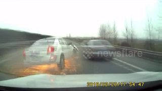 Dramatic video shows overtaking car sent flying across road - Video