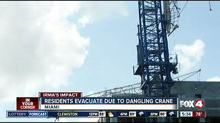 Miami police and fire crews evacuating residents living near collapsed crane, following Hurricane Irma - Video