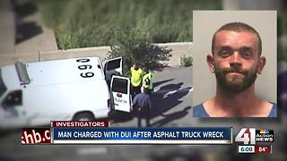 Asphalt truck driver charged with DUI following crash - Video