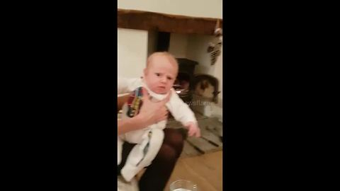 Four-week-old baby slightly put out at dad's sneeze