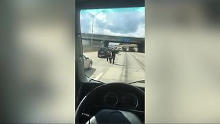 Video shows special needs child walking in middle of metro Detroit highway - Video