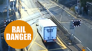 Dozy van driver banned for smashing through a level crossing to try to beat the barriers - Video