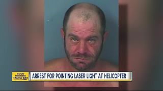 Man arrested for pointing laser light at sheriff's helicopter - Video
