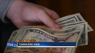 Cashless kids: digital dollars impact on children - Video