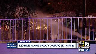 Mobile home damaged after fire in Chandler - Video
