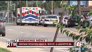 SWAT called to hostage situation on Indy's west side, area evacuated - Video