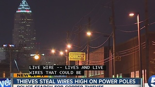 Thieves steal wires high on power poles - Video