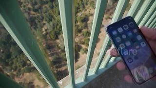 Tech vlogger drops iPhone X from tallest bridge in California - Video