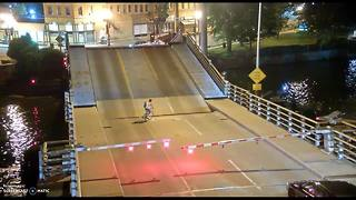 Menasha woman injured after riding bike into open bridge span - Video
