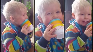 Toddler laughs hysterically at cup making rude noises - Video
