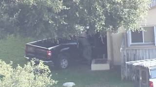 Truck crashes into Pasco home, 4 injured - Video