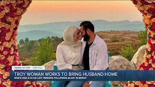 Troy woman works to bring husband home