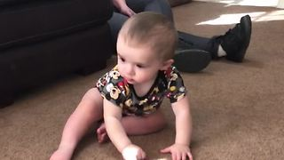 Confused Baby Tries To Pick Up Light Reflection - Video