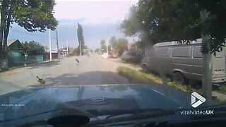 Loose Tire Goes Flying Toward Oncoming Driver - Video